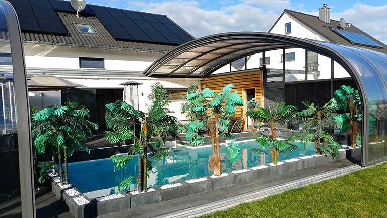 High pool roof on house wall VÖROKA DOMICIL